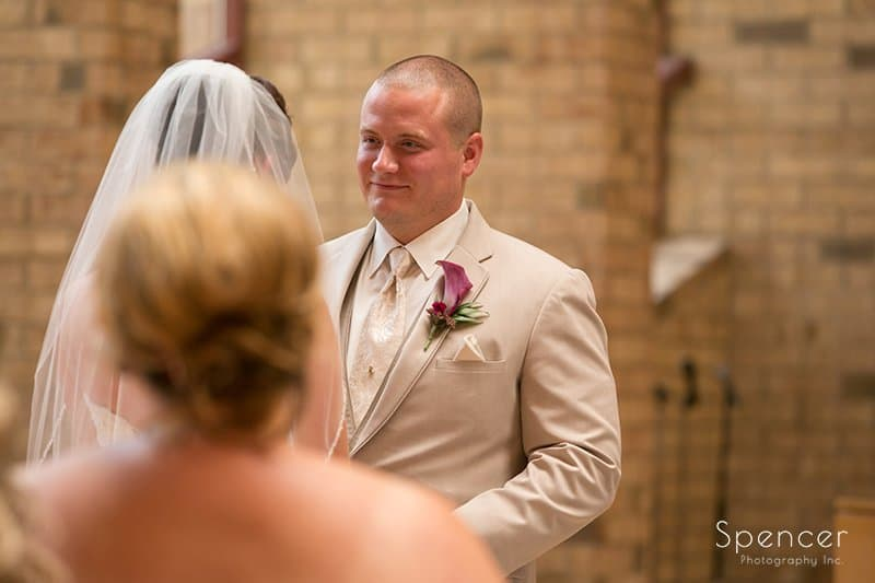 groom smiling at bride during wedding ceremony at Montrose Zion Church