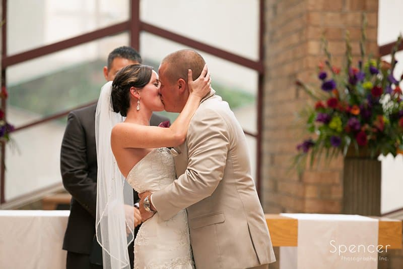 first kiss after wedding ceremony at Montrose Zion Church