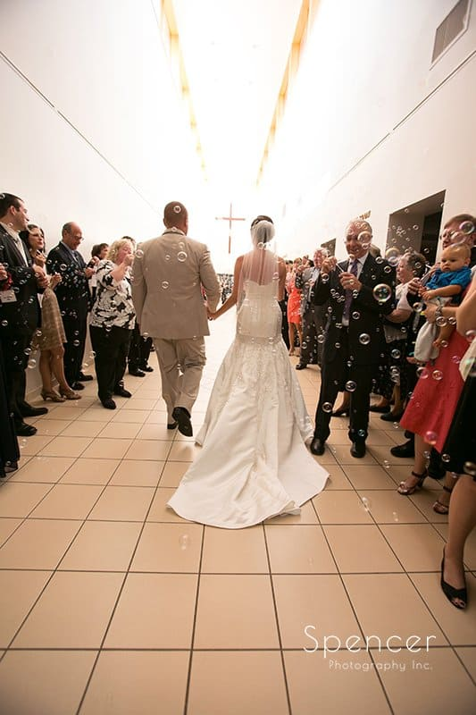 bride and groom exit wedding ceremony at Montrose Zion Church