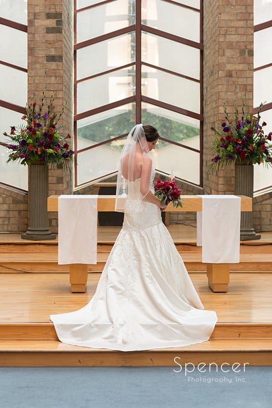 wedding portrait of back of brides dress at Montrose ZIon Church