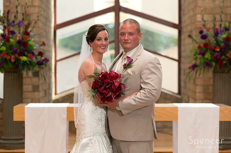 traditional wedding portrait of bride and groom at Montrose Zion Church