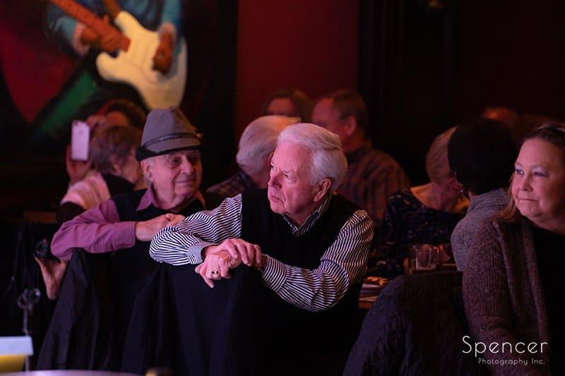man hugs Dan Zola at retirement gig in Lakewood