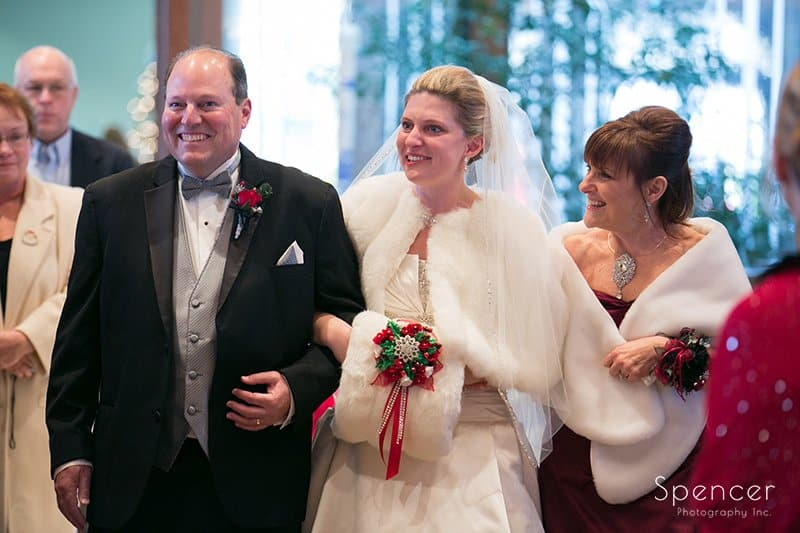 parents walk bride down aisle at wedding Ceremony at Holy Angels Church
