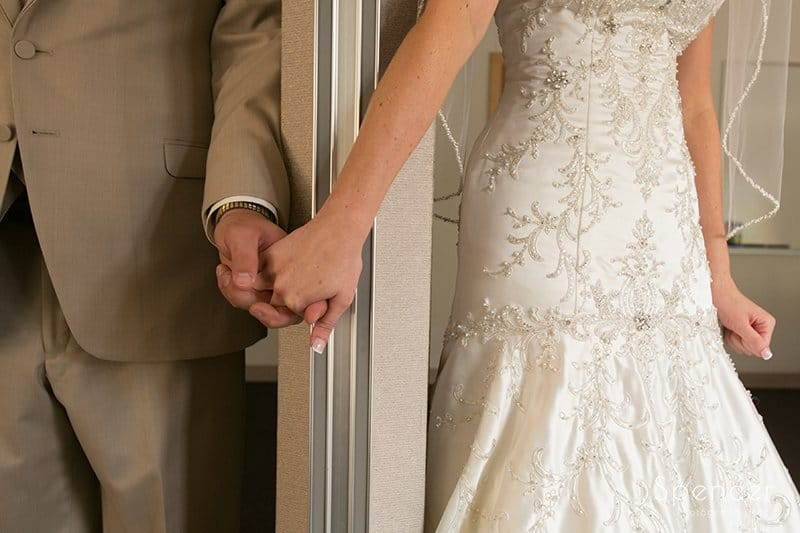 bride and groom holding hands at Montrose Zion Church