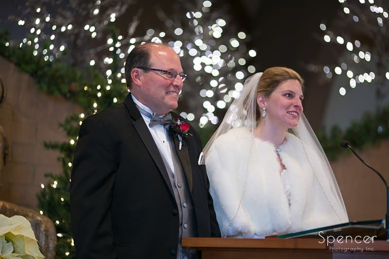 bride and dad at altar during wedding ceremony at Holy Angels