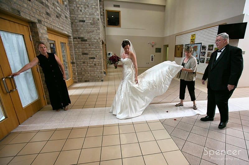 bride prepping to walk down aisle at wedding ceremony at Montrose Zion