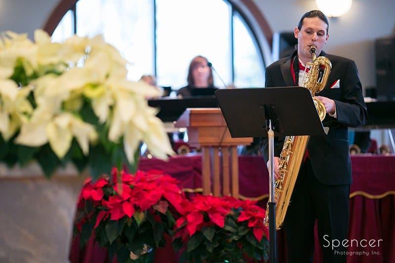 groomsman playing song at Holy Angels wedding