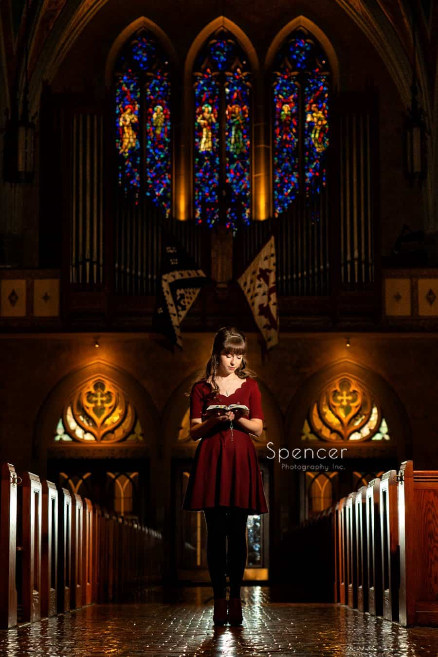 high school senior ready bible in her senior portraits in Cleveland