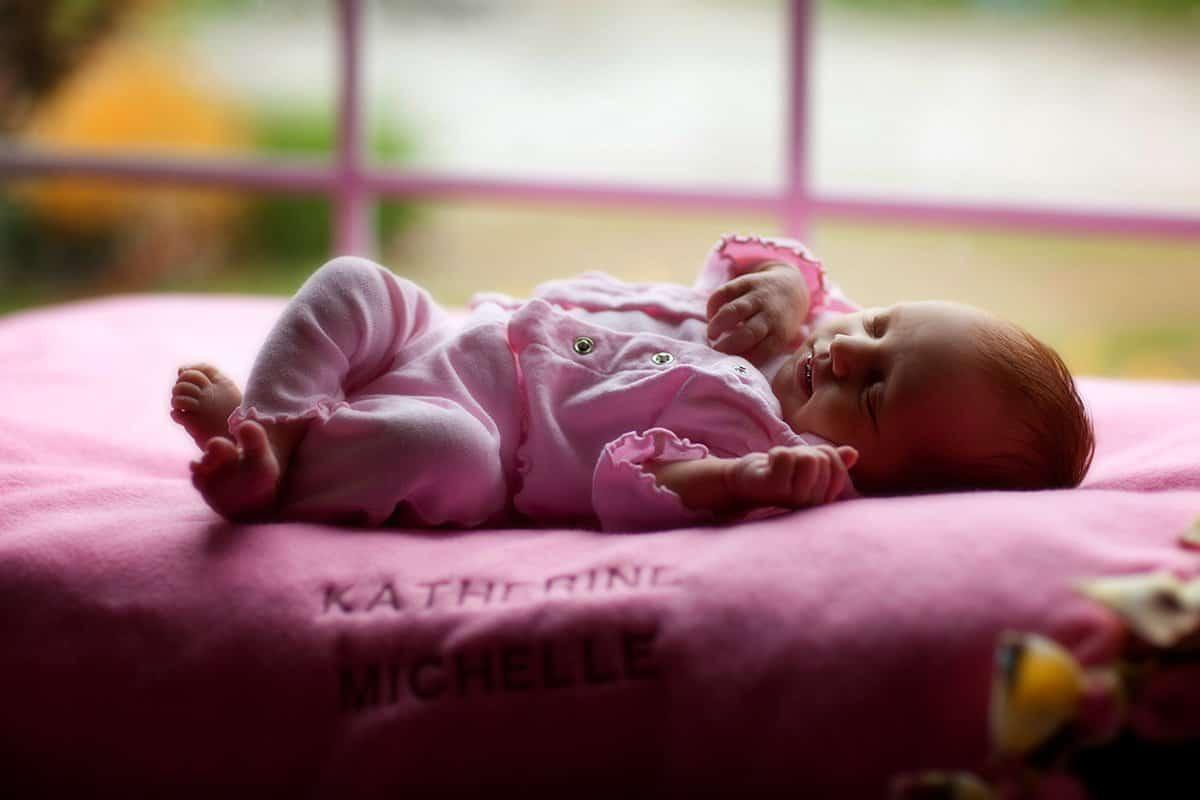 newborn baby on pink blanket