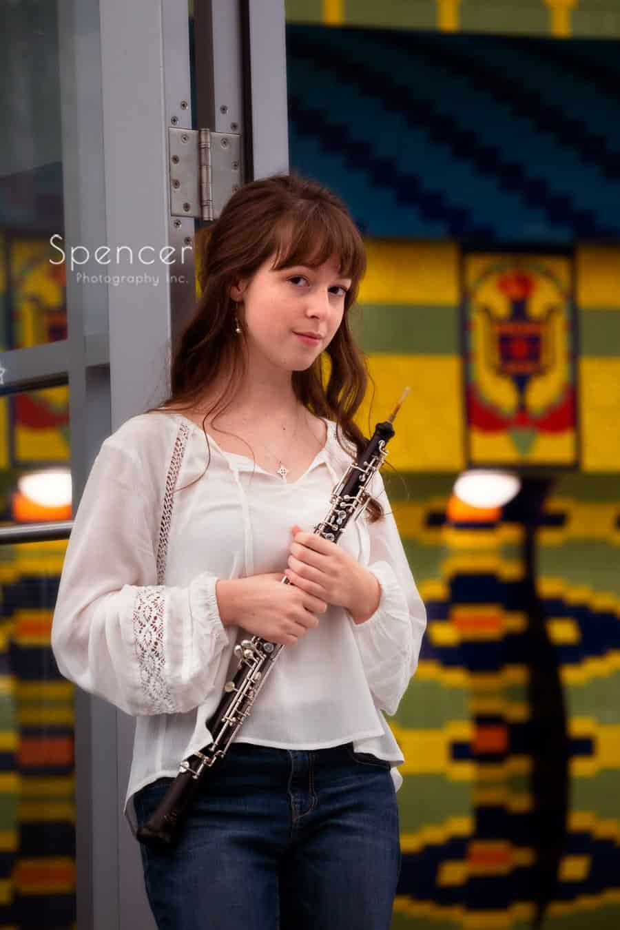 senior picture in Cleveland Library of girl holding oboe