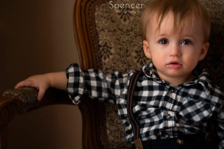 toddler photography of little boy in chair
