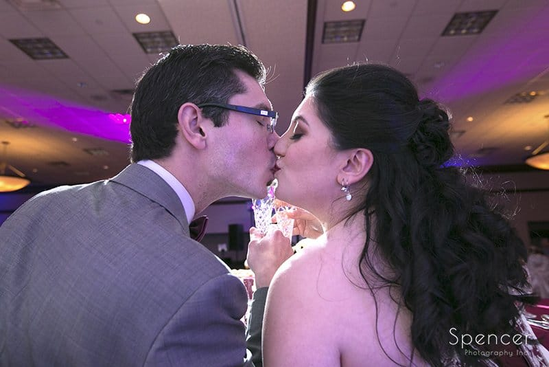 bride and groom kiss at their wedding reception at Cleveland Marriott