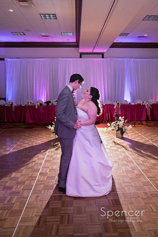 bride laughs with groom during first dance at Cleveland Marriott