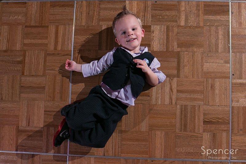 little boy laying on dancefloor at Cleveland Marriott