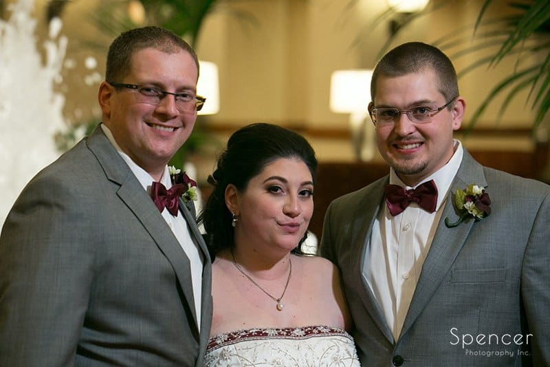 bride staning with brothers at Cleveland Marriott East