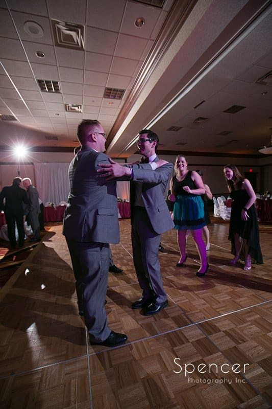 groom dances with dad at wedding reception at Cleveland Marriott East