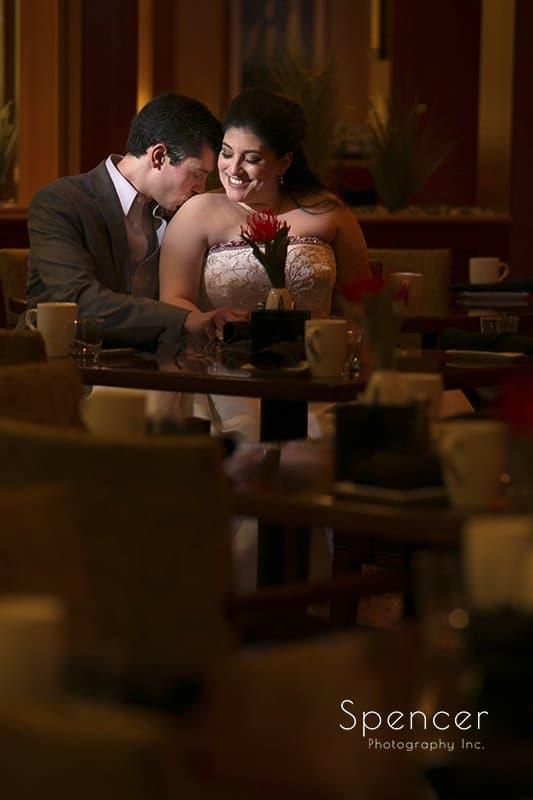 groom kissing brides shoulder in wedding picture at Cleveland Marriott East