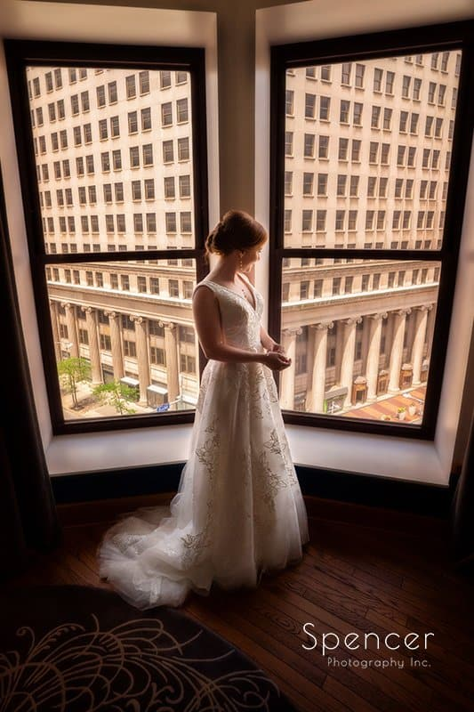 Bride standing in Cleveland Kimpton Schofield Hotel on wedding day
