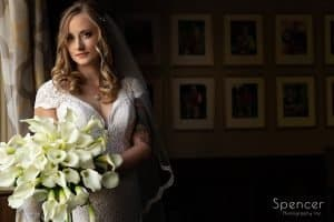 bride holding wedding bouquet at Firestone Country Club