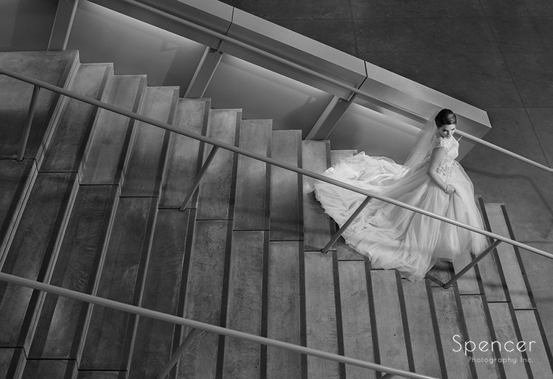 creative wedding picture of bride on stairs at Akron Art Museum