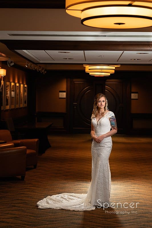 wedding picture of bride in hallway at Firestone Country Club