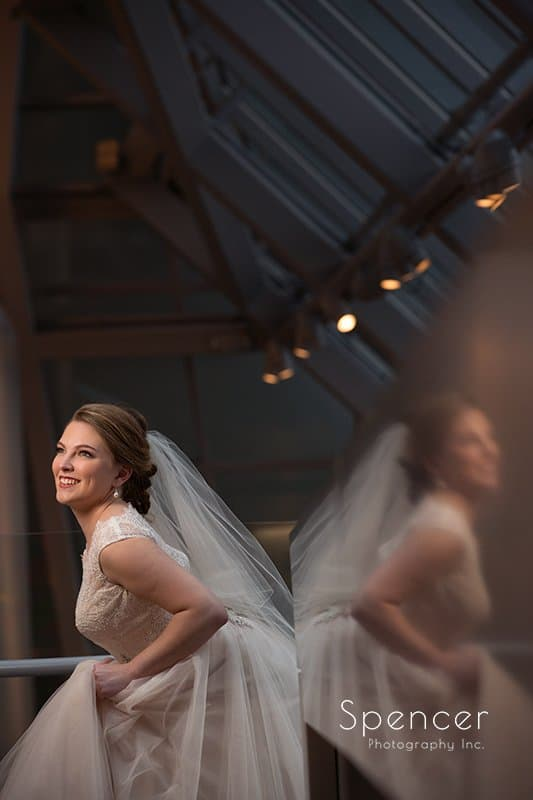 wedding picture of bride with reflection at Akron Art Museum