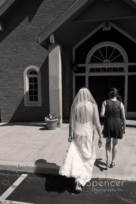 bride walking into divine word church wedding ceremony