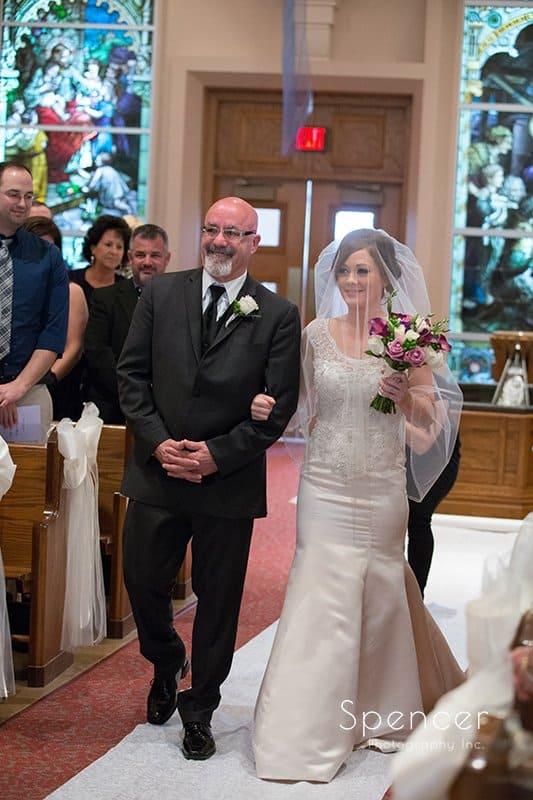 dad walking bride down aisle at wedding at St. Paul's Catholic Church