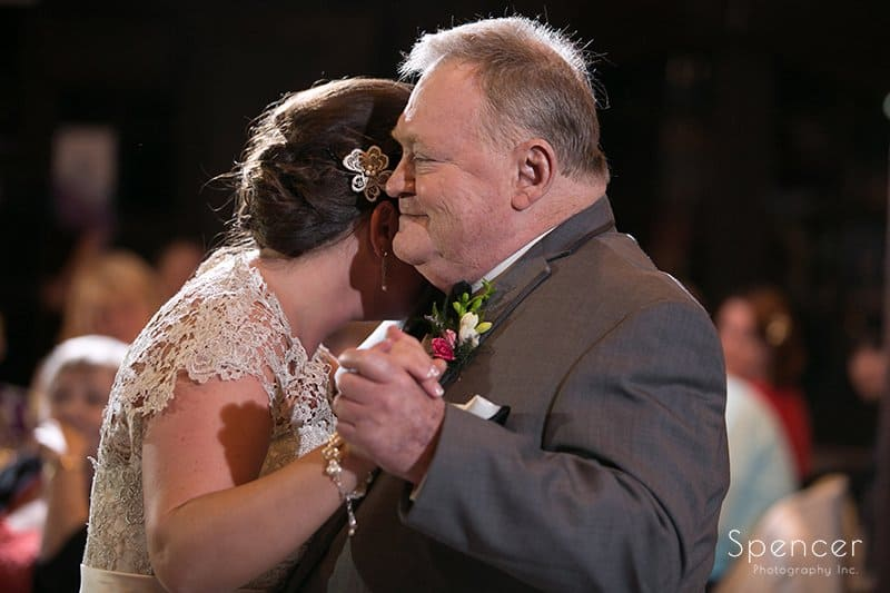 bride hugs dad during dance at Happy Days Lodge
