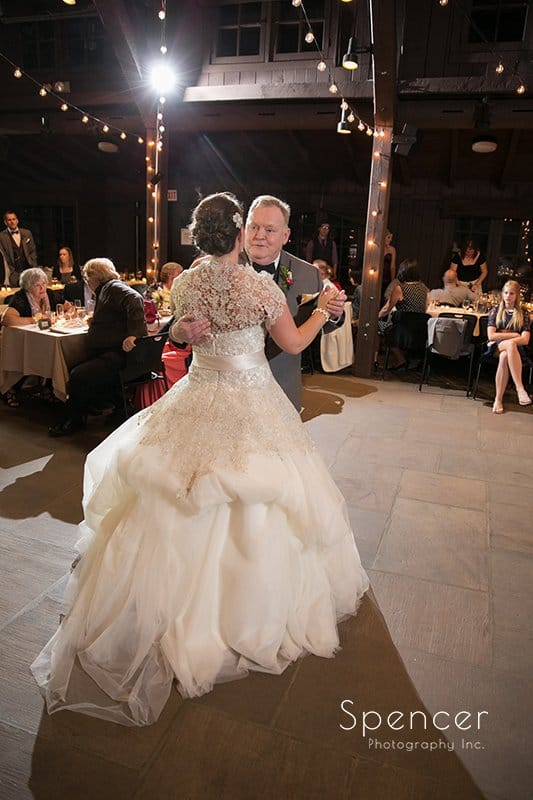 full length picture of dad dancing with bride at Happy Days Lodge