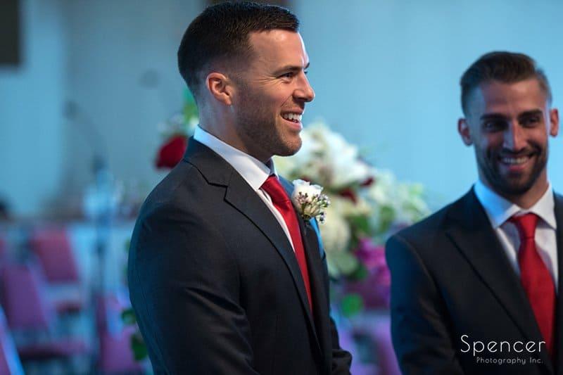 groom watching bride walk down aisle at Divine Word Church Kirtland