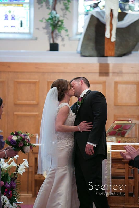 First kiss at wedding at St. Paul's