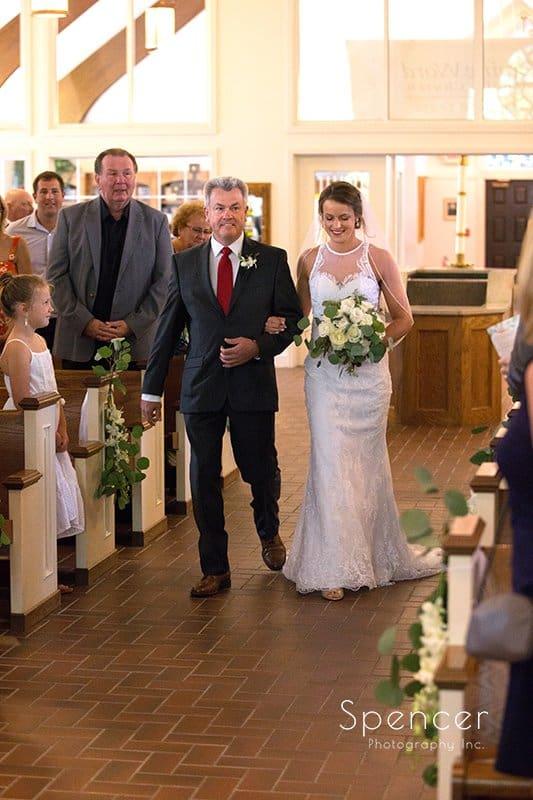 dad walking bride down aisle at Divine Word Church