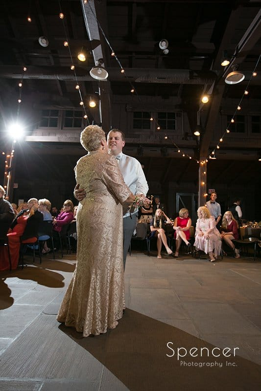 full length picture of groom dancing with mom at Happy Days Lodge