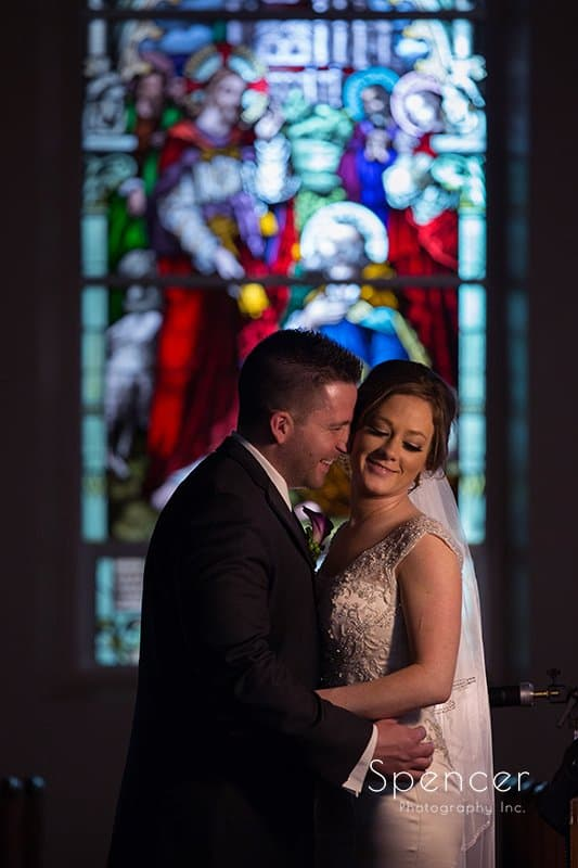 bride and groom hug after their wedding ceremony at St. Paul's Catholic Church