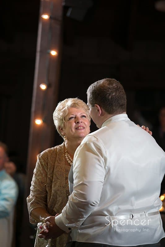 mom smiling at groom during reception dance at Happy Days Lodge
