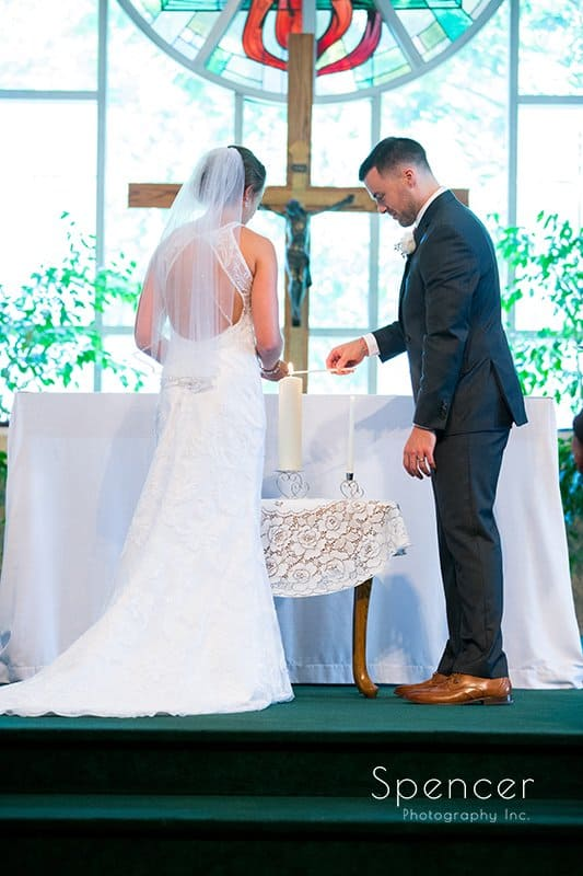 bride and groom lighting unity candle at Divine Word Church