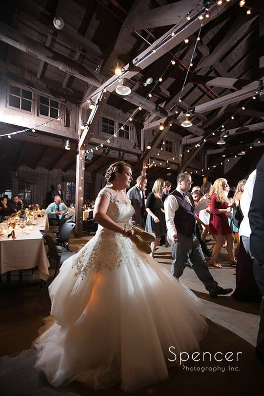 bride dancing at her wedding reception at Happy Days Lodge