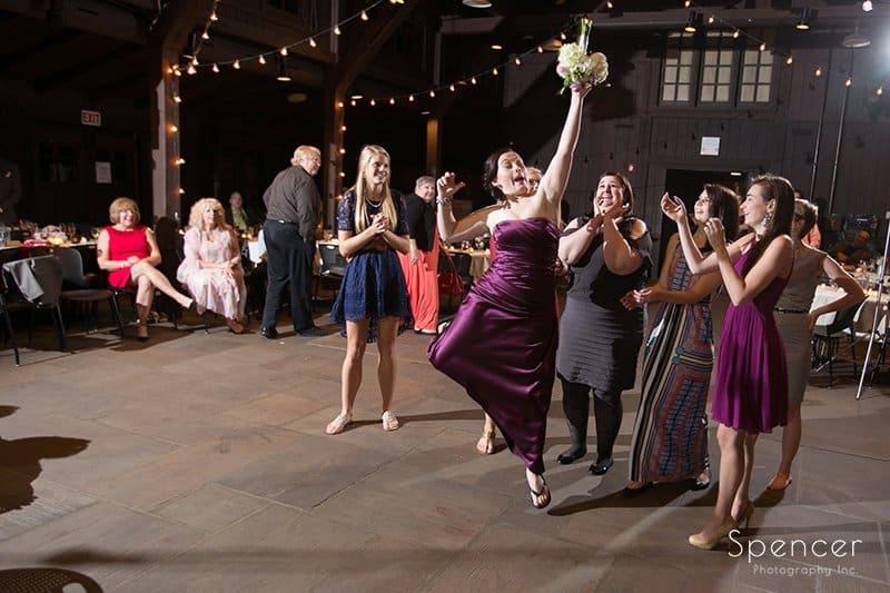bridesmaid catching bouquet