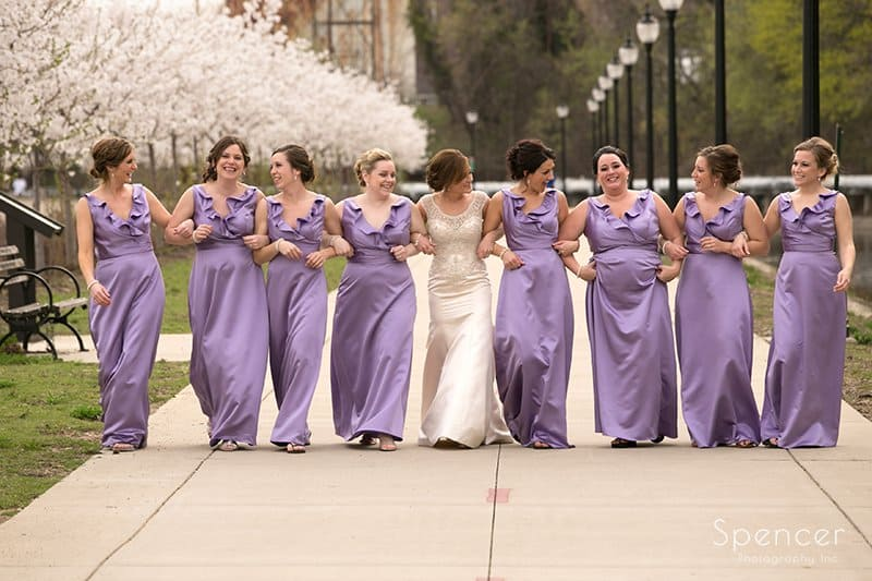 bridesmaids walking together in downtown Akron