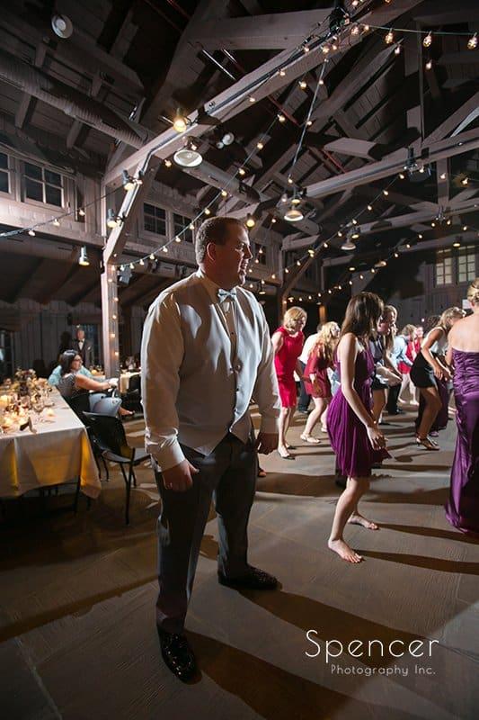 Groom dancing at his wedding reception at Happy Days Lodge