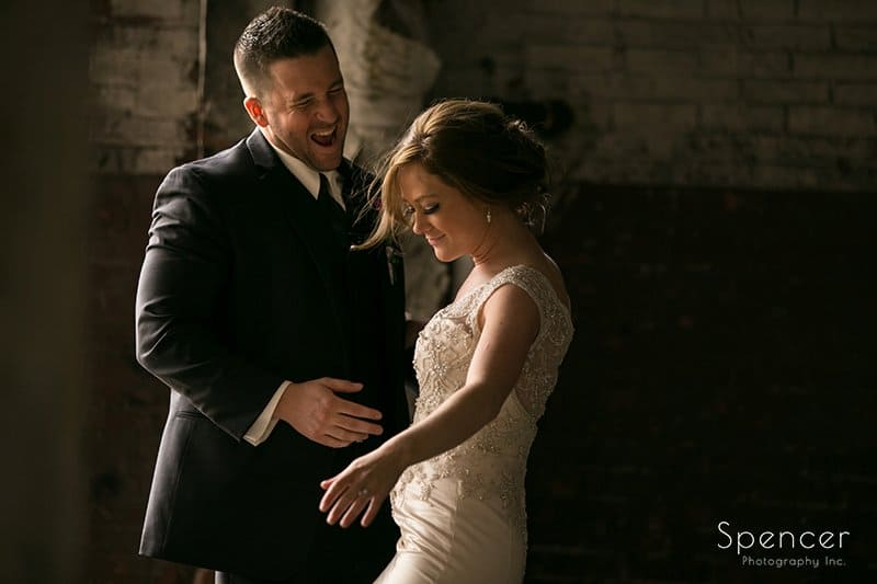 bride and groom dancing in old warehouse on wedding day