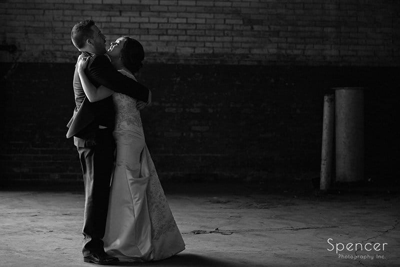 black and white picture of bride and groom hugging