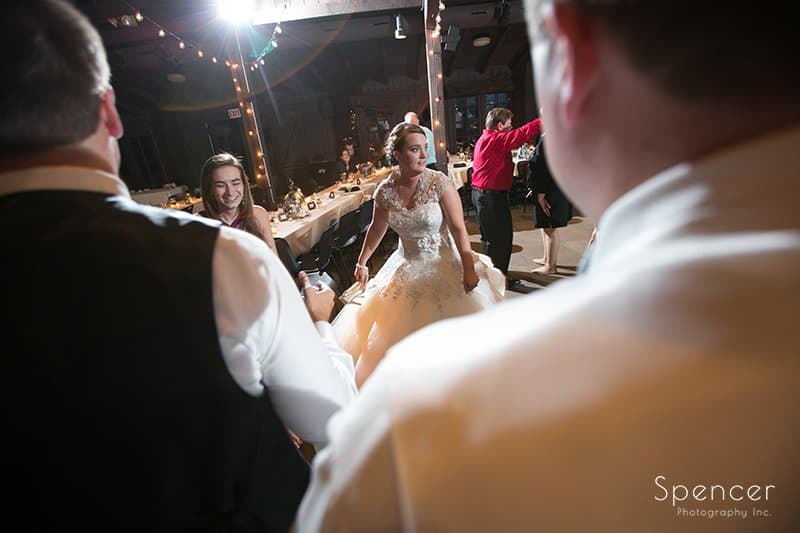 bride dancing with wedding guests at Happy Days Lodge