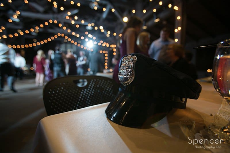 police hat wedding reception detail at Happy Days Lodge