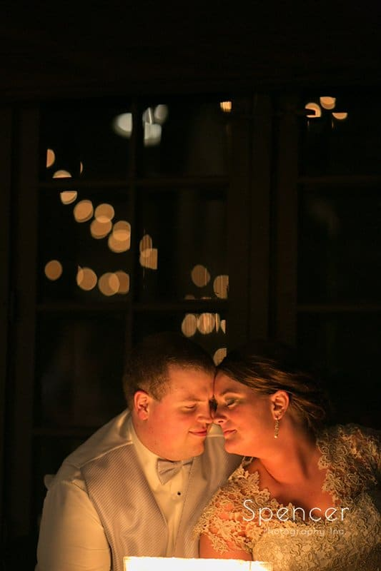 bride and groom cuddle after wedding reception at Happy Days Lodge