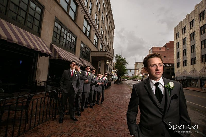 creative picture of groom in downtown akron