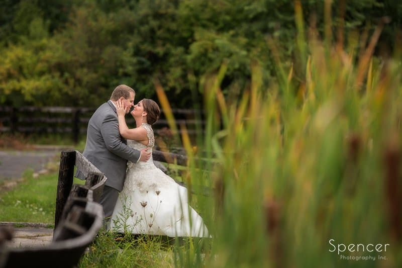 bride and groom kissing outside of Happy Days Lodge