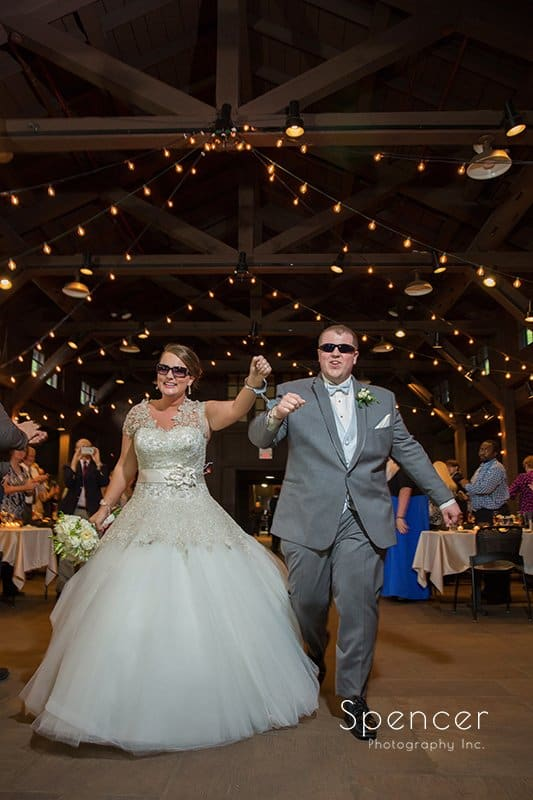 bride and groom enter their wedding reception at Happy Days Lodge