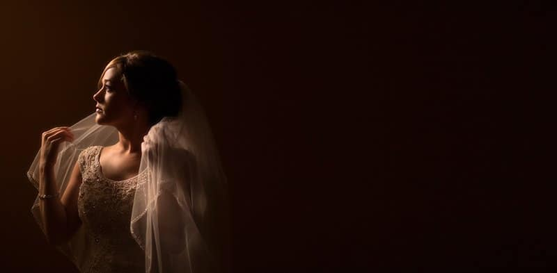 beautiful wedding portrait of bride holding veil at st pauls